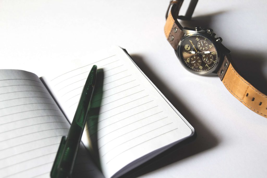 Watches next to a notepad